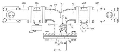 【図2】同給水装置の一対の連結管と逆止弁装置と合流管とを示す一部断面図。